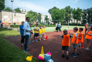 Children on the football pitch visited by the Mayor of Warsaw